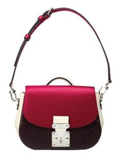 We love the structured feel of this ladylike bag and the sophisticated mix of berry and ivory.