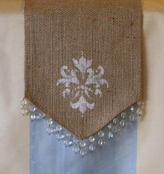 Items similar to Burlap Table Runner with Hand Stenciled Fleur Design w/ Bead Swag Trim 8 inches X up to 72 inches on Etsy Burlap Fabric, Burlap Lace, Hessian, Table Runner And Placemats, Burlap Table Runners, Burlap Projects, Burlap Crafts, Crafty Ideas, Sewing Crafts