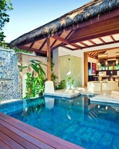 Beach Pool Villas have an outdoor bathroom and a terrace with views of the lagoon - LUX Maldives