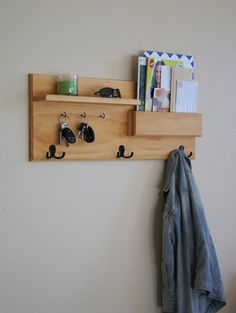 Keep your home stylishly organized with this Midnight Woodworks original design. Our handcrafted wall mounted coat rack is an excellent entryway storage solution. Perfect for mail, keys, coats, backpacks and other necessities! This custom built flush-mount one-shelf organizer is made using solid wood stained Honey Maple but can be custom ordered, see photo #5 for options. Three black double coat hooks provide storage for your bags, backpacks and other necessities...and theyre strong enough…
