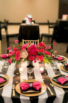 Kate spade inspired centrepiece with shades of pink with gold black and white stripe accents. Protea, dahlia, roses - floral by Bloom and Co. Decor by Gala Decor. photo by Andreas Impressions - planned by A Divine Affair www.adivineaffair.ca