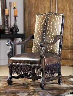 Love the deerhide and twisted leather fringe! Beautiful western chair.