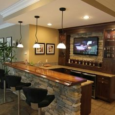 Stacked stone home wet bar with u shaped layout Basement Bar Plans, Basement Bar Designs, Home Bar Designs, Basement Makeover, Basement House, Basement Kitchen, Basement Renovations, Home Remodeling, Finished Basement Bars
