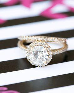 Engagement Ring + Band from Brilliance.com -- see more on #smp here: http://www.StyleMePretty.com/southeast-weddings/2014/04/18/raspberry-striped-wedding-inspiration/ Photography: AmalieOrrangePhotography.com