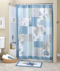 "Designed with the elegance of spring in mind, the Meadow Bath Collection refreshes your bathroom with its graceful floral motif. The patchwork design of the cotton and polyester Shower Curtain (72"" sq.) brings in blue, green and gray tones through a vari"