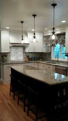 White kitchen with granite but black island.  Pendant lighting.