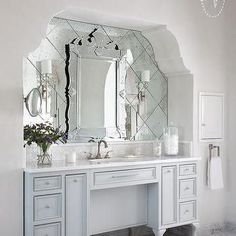Arched Bathroom Alcove with French Washstand and Venetian Mirror Layered Over Antiqued Mirror