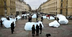 """""""Ice Watch"""" is a circle of icebergs, installed at the Place du Pantheon during this week's Climate Change Conference, by icebergs for an installation in Paris called """"Ice Watch,"""" by the Icelandic artist Olafur Eliasson and the geologist Minik Rosing."""