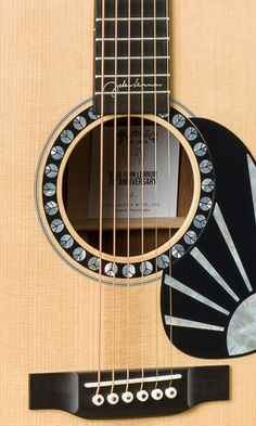 To commemorate John Lennon's 75th Birthday, this D-28 model #MARTIN #GUITAR is limited to 75 INSTRUMENTS FOR JOY - www.pinterest.com/DianaDeeOsborne/instruments-for-joy/ - Solid Adirondack spruce top, Vintage Tone System. Madagascar rosewood back inlaid with HD-28 style zig-zag peace sign marquetry. The Madagascar rosewood headplate is adorned with John Lennon's famous self-portrait illustration that rests beneath the Martin script logo. List price $11,999.