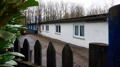 With refugees streaming in, Germany is running short of places for them. One city has proposed housing refugees in a barracks on the grounds of the notorious Buchenwald camp.