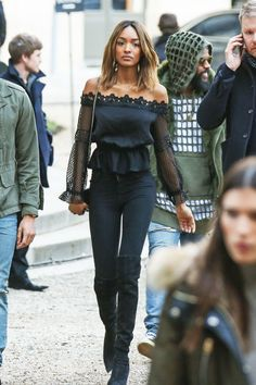 Jourdan Dunn rocks an all black ensemble, featuring lace detail and knee-high boots.