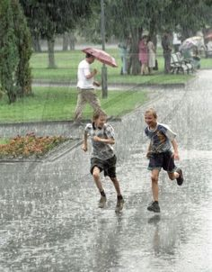Many adults complain when it´s a rainy day, but the kids just love it. Get a hold of these amazing photography of the kids playing in rain. Weather Rain, Rain Days, Running In The Rain, Walking In The Rain, Smell Of Rain, I Love Rain, Rain Go Away, Under The Rain, Rain Storm