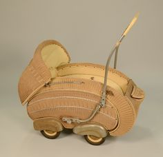 ART DECO WICKER PRAM, attributed to Alfons Pollack