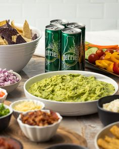 A perfect party deserves guacamole and a refreshing can of Perrier. Proper Tasty, Cotija Cheese, Ripe Avocado, Tortilla Chips, Yummy Appetizers, Cherry Tomatoes, Guacamole, Meal Planning, Stuffed Peppers
