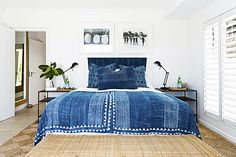 High on the mountainside overlooking Plettenberg Bay lagoon, Indigo House commands a spectacular view and boasts signature indigo, white and wood interiors. Fabric Rug, Rental Property, Pools, South Africa, Indigo, Tile, Vacation, Rugs, Bed