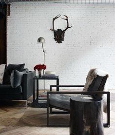 I'm loving what designer Jenny Wolf did to this space. She tricked it out with glamorous + masculine goodness.