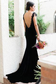 The bride wore black — click to shop wedding dress alternatives.