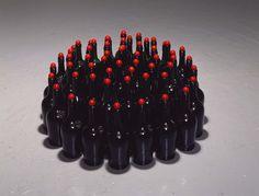 "Tony Feher [USA] (b 1956) ~ ""Birth Stone"", 2008. Glass bottles, glass marbles (35.6 x 76.2 cm). | #art #sculpture #installation #conceptualart #assemblage"