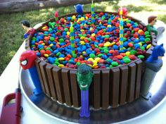 My addition to the standard KitKat Cake.  I used superhero pez despensers, but you could use any theme.  Super easy to do!