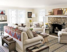 Architecture: The stone hearth was the house's best original architectural feature. To emphasize it, Woodard added a slab of natural stone for a mantel and finished it off with dentil trim. Flooring: Woodard had the floors patched and painted a soft gray-beige — the perfect backdrop for the Woodard Weave rugs he sells in his shop. Shown: the Geometric Checkerboard pattern, #90-G.   - HouseBeautiful.com