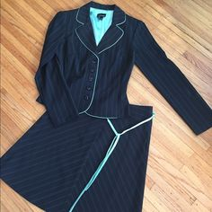 Professional Black & Mint Pinstripe Skirt Suit Professional Black & Mint Pinstripe Skirt Suit. Size juniors 5/6. Skirt has thin mint green satin belt. In excellent condition. No signs of rips stains or flaws. My Michelle Skirts