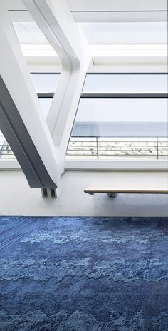 Milwaukee Art Museum. In a Blue State of Mind. Net Effect is a carpet tile collection inspired by the Ocean that contains 100 percent recycled content yarn. More information: www.interface.com/neteffect