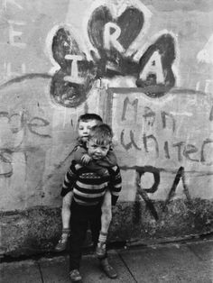 Two Dirty Boys Stand in Front of Ira Graffiti in Northern Ireland