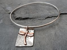 Hand Made Sterling Silver bangle, with dragon fly tag – Hearts of Brass http://www.heartsofbrass.co.uk