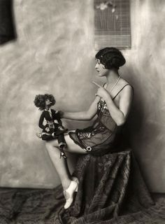 A Ziegfeld Girl with her smoking boudoir doll. One of my all-time favorite photos.