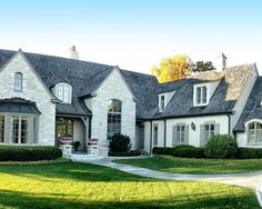 French country style home #curb #appeal #facade #exterior #gray #white #stone