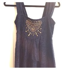 Free people top Only worn once lovely flowy free people top with bead detail. Free People Tops