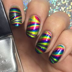 Nicole glosses her tips with colors depicting that of a RAINBOW using the 4 polish shades from her Formula X #InfiniteOmbre lacquer kit. The set was gifted to her for being part of the Preen Me VIP Program.
