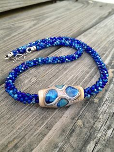 Kumihimo Beaded Necklace with Lampwork Focal Bead. $49.00, via Etsy.
