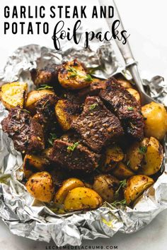 Juicy and savory seasoned Garlic Steak and Potato Foil Packs are the perfect baked or grilled 30 minute hearty, healthy meal! | lecremedelacrumb.com #foilpacks #beef #meatandpotatoes #garlicsteak #healthy #hobodinners #summermeals