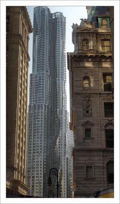 NYC. Gehry metal between stone walls.