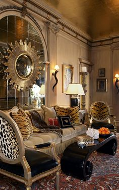 Mirrors on mirrors, gold ceilings, leopard!