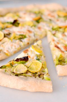 Bear with me now. Am I telling you to put lemons and Brussels sprouts on a pizza? Why yes, I am, but trust me on this. This pizza is so delicious. Remember when I said just how excited we get when … Parmesan Pizza, Burrata Cheese, Spanakopita, Pizza Recipes, The Fresh, Lemon, Vegetarian, Favorite Recipes, Homemade