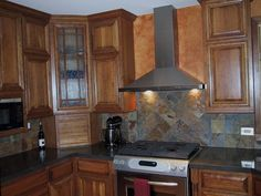 Concretecountertops And Multicolor Slate Backsplash Are In Place