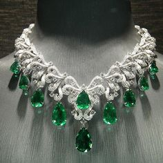 Like this post if you love this sparkling green emerald and diamond necklace! Find them at
