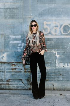Embroidered boho blouse with fluted sleeves and black velvet flare pants