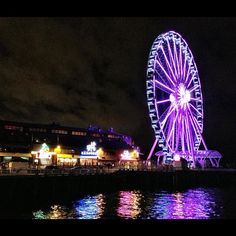 The Seattle Great Wheel in Seattle, WA. I want to go on the giant Ferris Wheel. That will be right after I get over my fear of heights.
