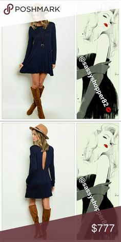 Coming soon Just in!!  Limited quantity.  Will be $42  Navy blue long sleeved dress with peekhole back. Pair with boots, floppy hat and a fur vest for a complete look. Dresses