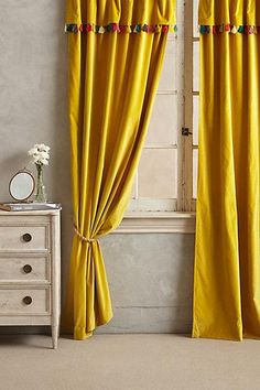 Wallpaper - Firenze Velvet Tassel Curtain I anthropologie.com - yellow velvet…