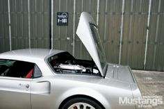 See the rear air vents? Yep that's a mid engined Mustang Mach 40 ...