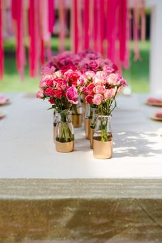 Style Me Pretty Audrey 3 - milk glasses (use starbucks frap? glasses) and paper flowers and purple or green paint?
