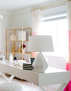 gold bookshelf, and cute lamp. Also love the white pouf for a footrest