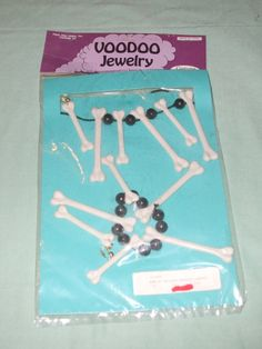 Found at a local estate, vintage plastic voodoo or bones necklace and bracelet. This is from a costume salesmans sample inventory from the
