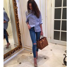 Ripped knee blue jeans, light blue top