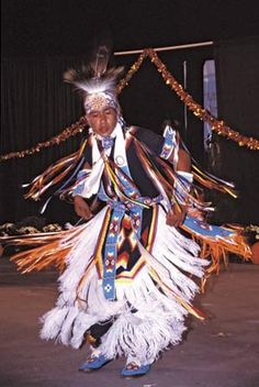 A Cherokee dancer in traditional attire performing in an annual festival, Cherokee, N.C.    Credit: Marilyn Angel Wynn/Nativestock Pictures
