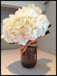 Bridal Shower center piece: white hydrangea, mason jar, burlap and raffia.